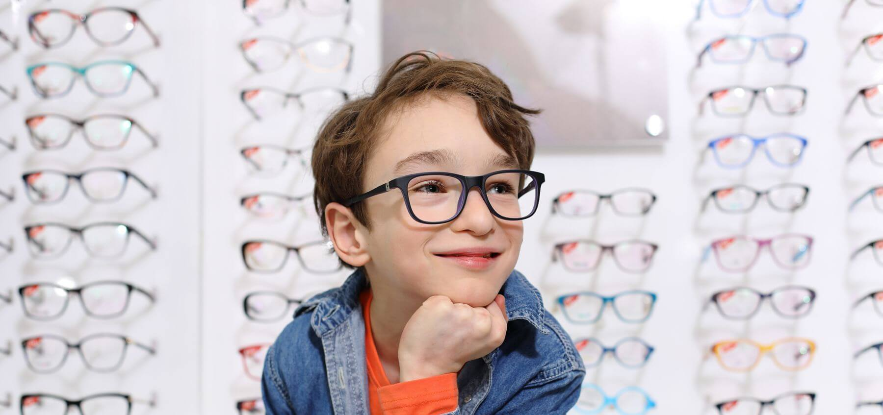 Envision Optical Boy wearing glasses smiling